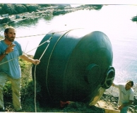 Ground transportation of rain water catchment tank. Lasqueti Is. BC.