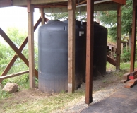 Rain catchment storage tanks under sun deck. San Juan Is. WA.