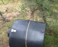 Rolling tank up a steep slope. San Juan Is. WA.