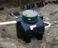 Floating outlet 'Flout' dosing tank for gravity powered effluent distribution to septic pressure field.  Kelowna, BC.